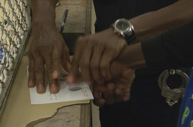 Suspect is fingerprinted