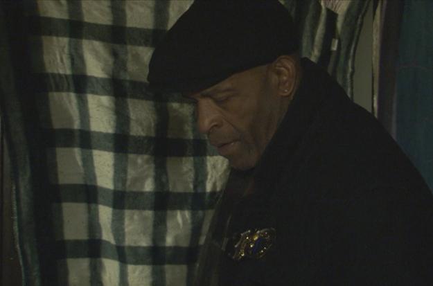 Detective Smith walks through crime scene