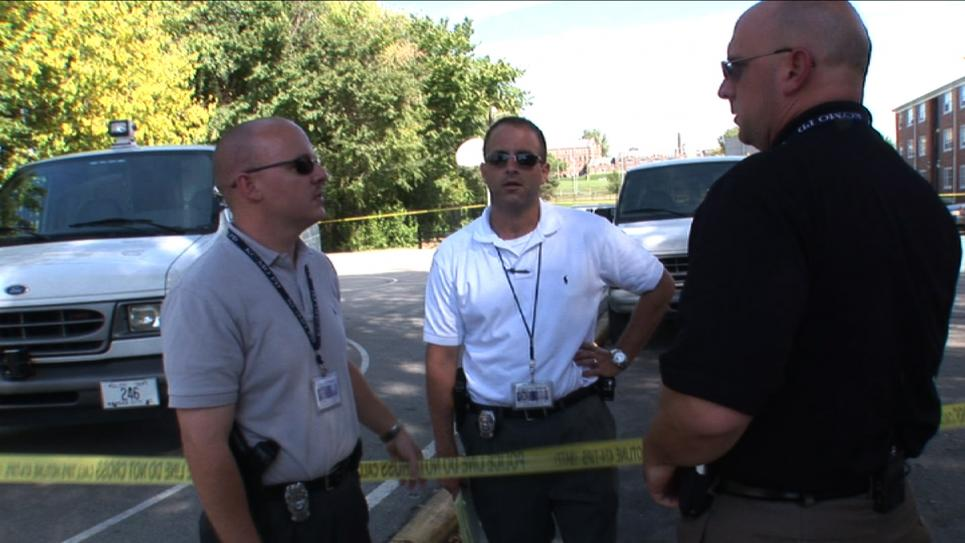 Officers hold discussion at crime scene