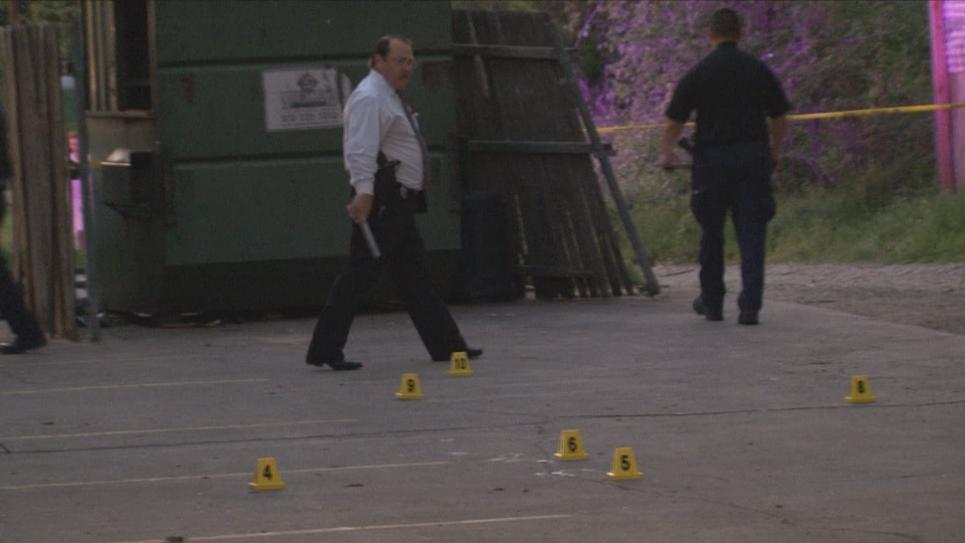 Detective Ellzey walks through crime scene
