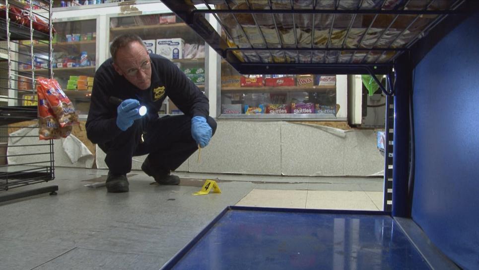 Detective Raynard looks for evidence