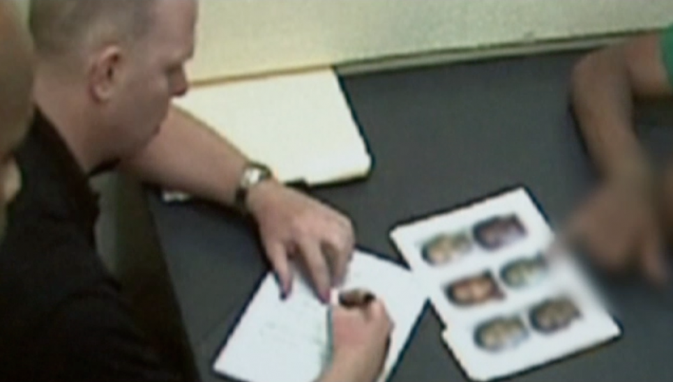 Detective Renaud shows photo lineup to witness