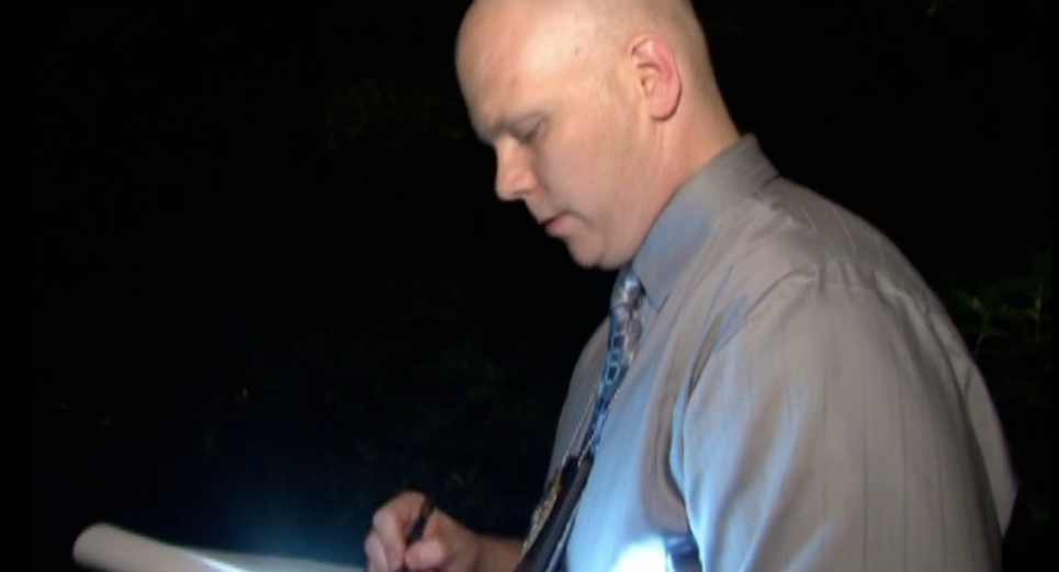 Renaud takes notes at DeKalb County crime scene