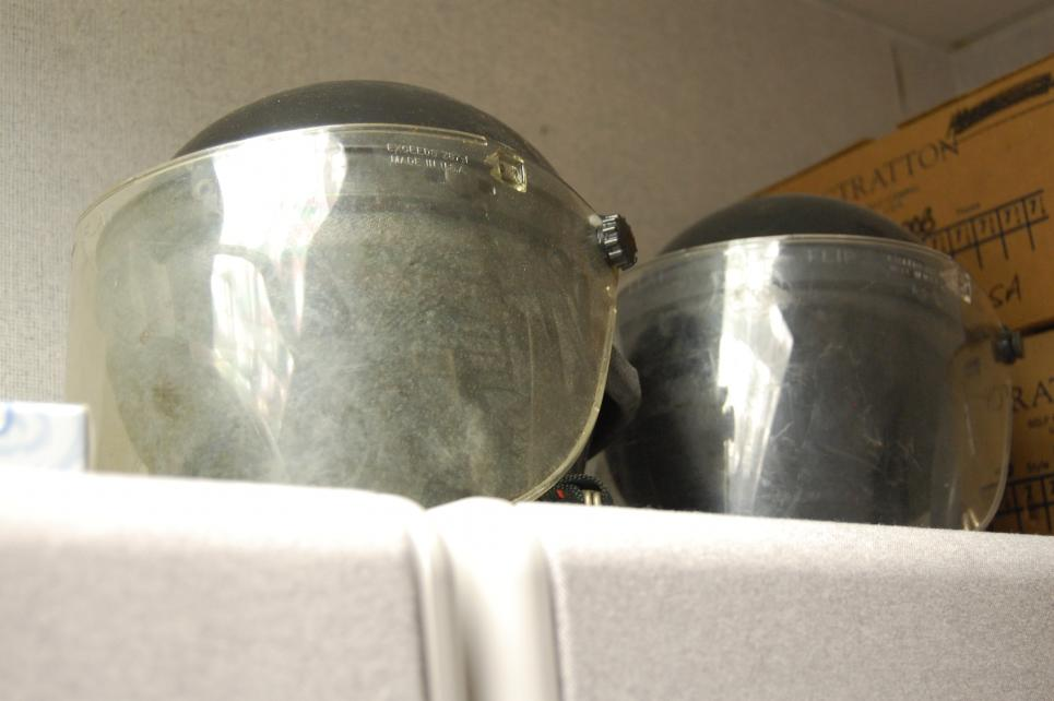 SWAT gear helmets are stored close by