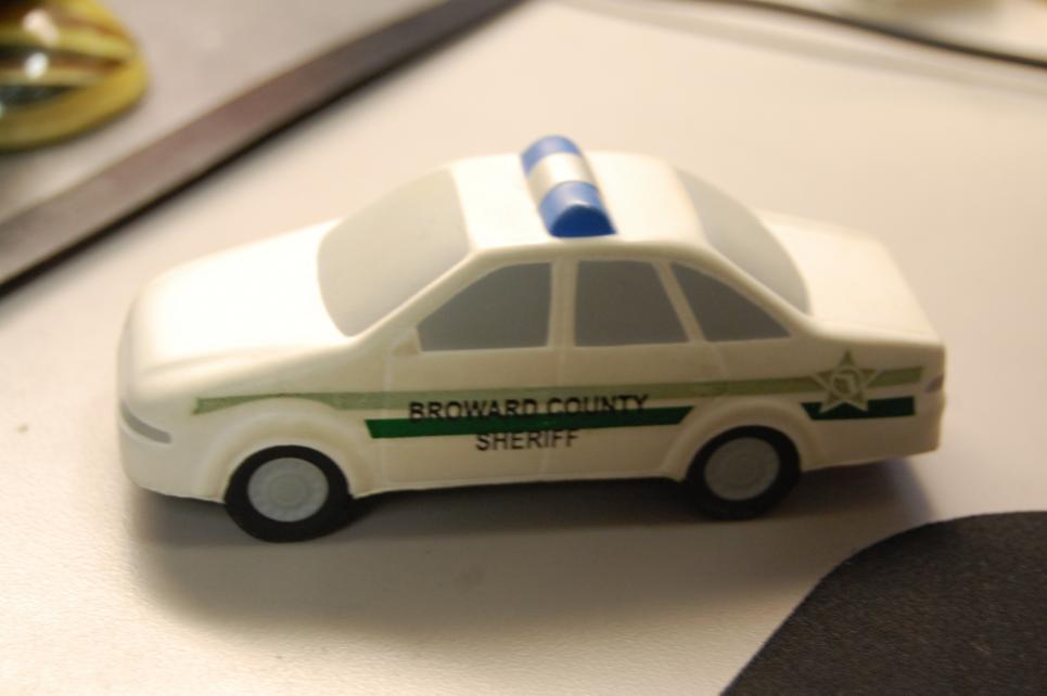 Small squad car is displayed on desk