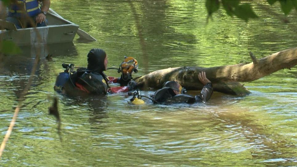 Dive team searches for murder weapon