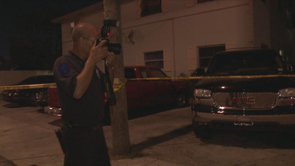 Crime Scene Investigator Yen photographs scene
