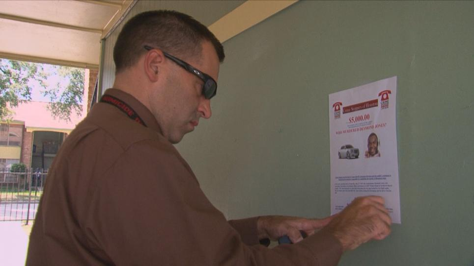 Deputy Jason Brown hangs flyers