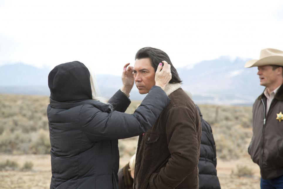 Crew member tames Lou Diamond Phillips' hair