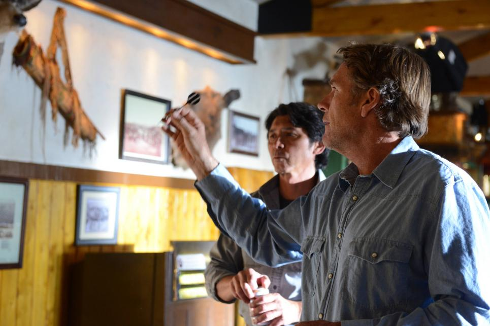 Longmire throws darts with Henry Standing Bear