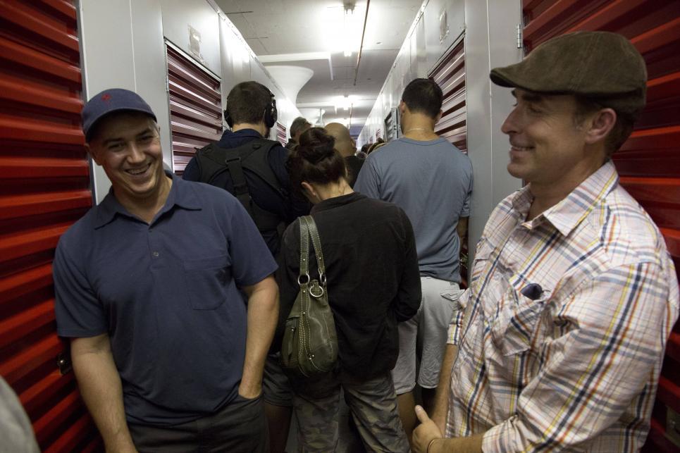 Chris and Tad joke before bidding