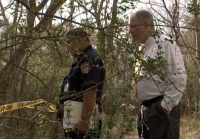 Sergeant Beall at crime scene in Harris County