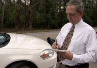 Reynolds takes notes at crime scene