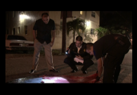 Miami detectives check clothing for evidence
