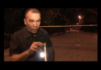 Detective Castillo looks  for evidence