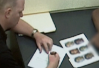 Detective Renaud shows photo lineup to witness