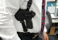 One side of holster houses detective's firearm