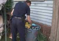 Detectives search trash for clues