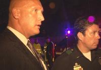 Detective Yeric briefed by first responders