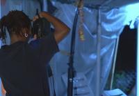 Crime Scene Unit member photographs scene