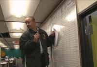 Sergeant Gonzalez adds notes to Miami Homicide murder board