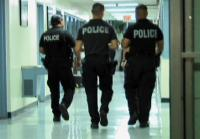 Officers walk hospital corridor