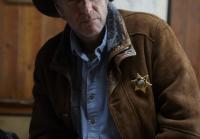 Longmire is played by Robert Taylor