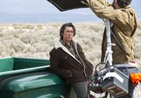 Lou Diamond Phillips leans against truck