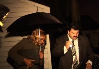 Umbrellas and flashlight aid officers
