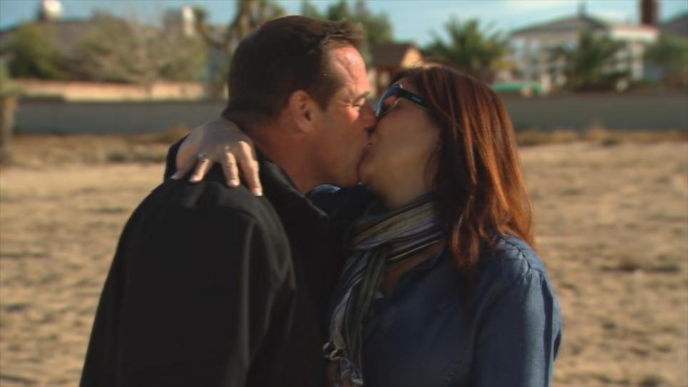 Antonio and Kitty kiss