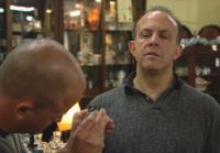 Steve examines diamond earrings