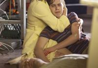 Norma Bates comforts her son