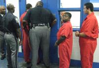 Officers and inmates tower over  Charlie