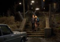 Norma helps Norman to car