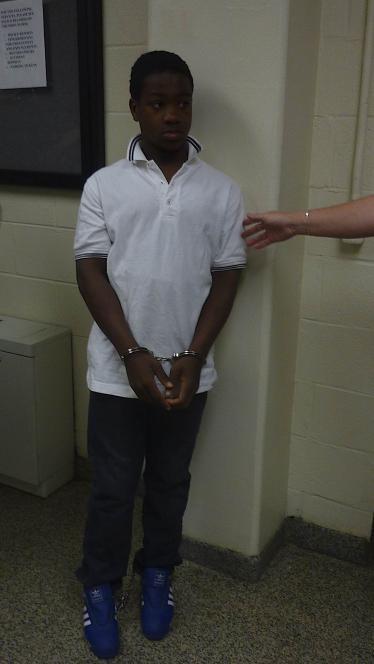 Jeme wears handcuffs