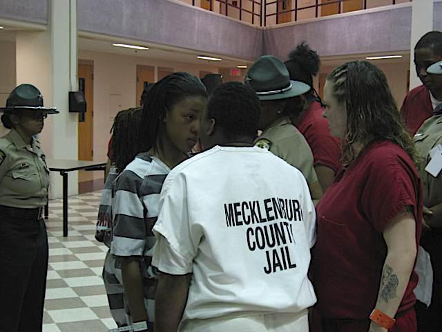 Mecklenburg inmates get in teen's face