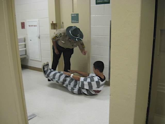 Sgt. Garrett makes Jose do sit-ups