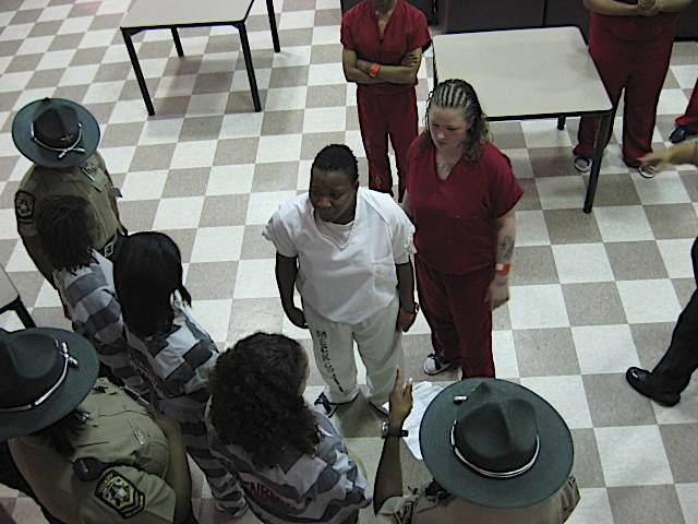 Female inmates share stories with girls