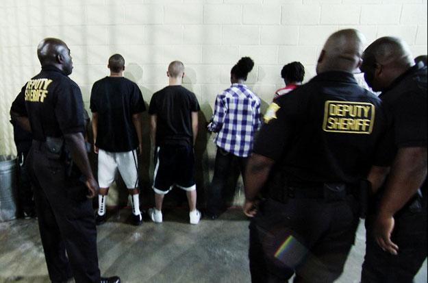 Teens against wall at Richard County Jail