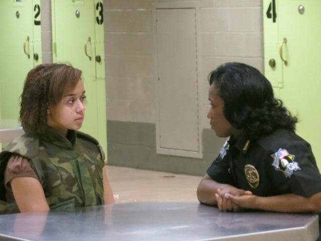 Deputy Corporal Hopkins helps Raven change