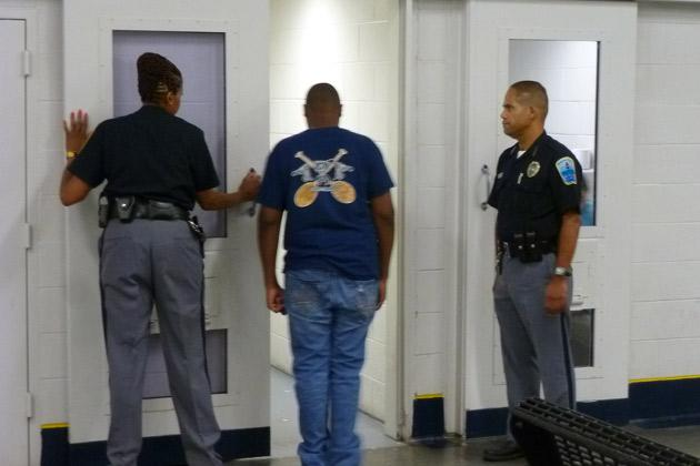 Robert enters holding cell