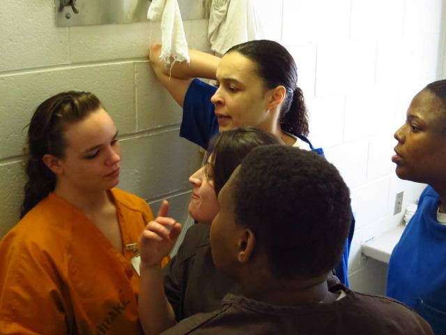 Inmates surround pot-smoking Tina