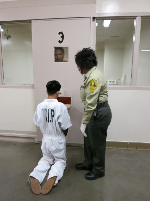 Teen forced to knees by  inmate