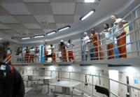 Inmates look down at teens