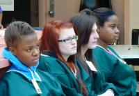 At-risk teens listen to female inmates