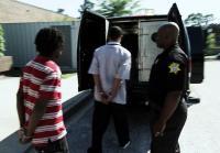 Teens climb into police van