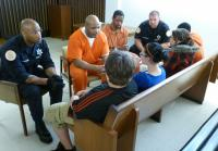 Inmates, officers and teens converse