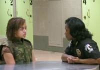 Deputy Corporal Hopkins helps Raven change