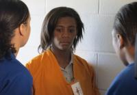 Inmates make Jahmiya give up her shoes