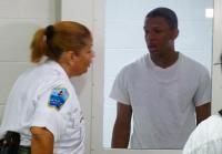 Jeffery speaks to Captain Kasey from inside cell